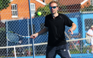 Individual player Dave hitting a forehand