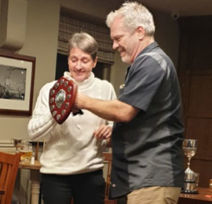 Caroline receiving award from Chairman Dan