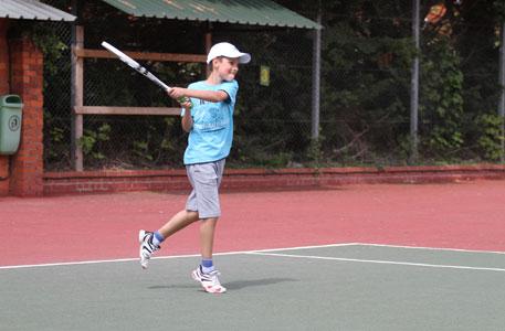 Junior hitting a backhand