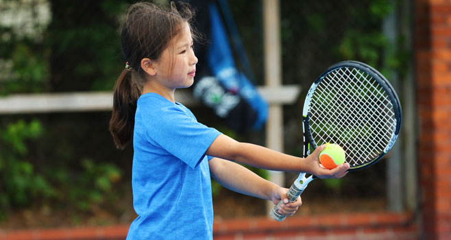 Junior Player getting ready to serve