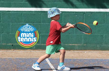 Mini Tennis Player hitting a red ball