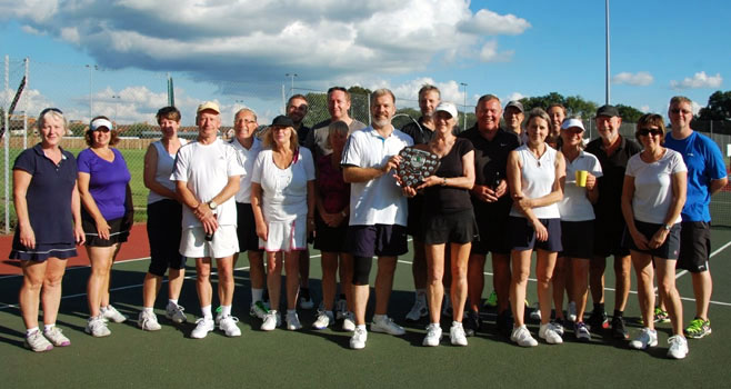 Members of Wells Tennis Club holding a shield