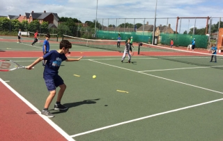 CHildren playing tennis at Wells Tennis Club