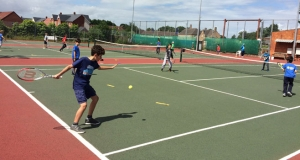 Juniors playing tennis
