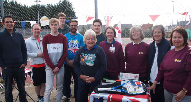 Blue School Students with Wells Tennis Club Members and head Coach
