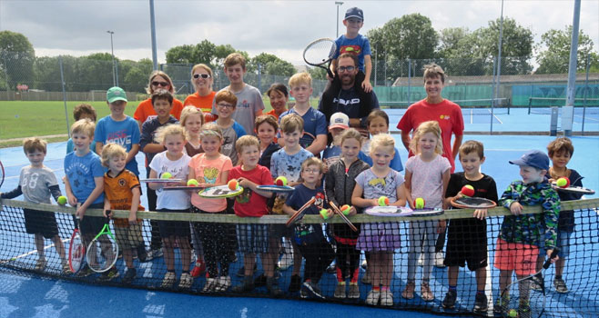 Group Picture of children and voluteers at our open day