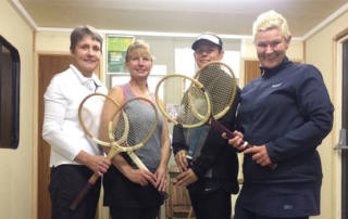 Wells Ladies A team, Caroline, Wendy, Marie and Julia (captain) posing with traditional wooden rackets.