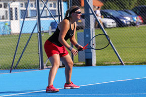 Adult in a ready position, female tennis player